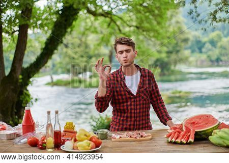 man cooking tasty food for french dinner party