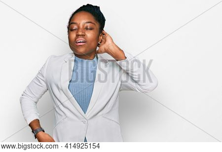 Young african american woman wearing business clothes suffering of neck ache injury, touching neck with hand, muscular pain