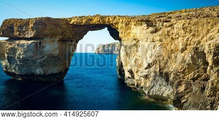 Azure Window, natural arch, famous landmark and popular tourist spot, on Gozo island, Malta