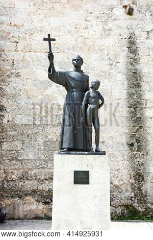HAVANA, CUBA - JULY 21, 2016: Father Junipero Serra and juaneno Indian boy statue at the Basilica Menor de San Francisco de Asis.