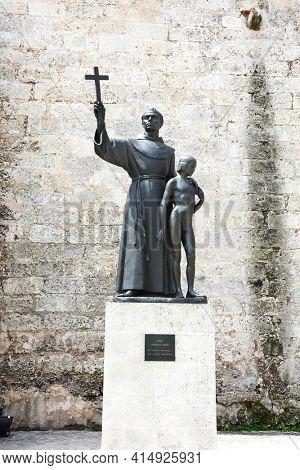 HAVANA, CUBA - JULY 21, 2016: Father Junipero Serra and juaneno Indian boy statue at the Basilica Menor de San Francisco de Asis.