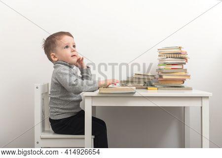 Closeup of cute small boy reading books