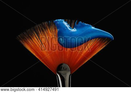 Fan Shaped Paintbrush With Paint In Blue Color At The Tip. Artistic Flat Fan Shaped Paintbrush Again