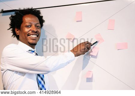 Businessman Using Sticky Notes On Business Meeting.