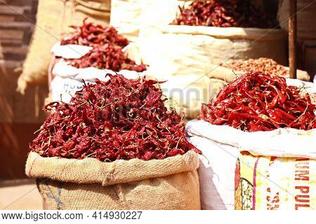 Fresh Whole Dry Red Chilies Stored In Bag For Sell In A Market Stall