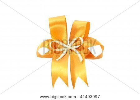 Big Gold Holiday Bow On White Background.