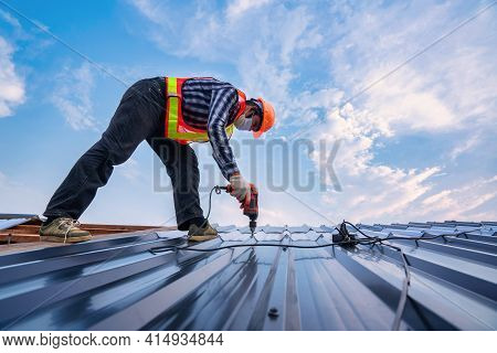 Roofer Working On Roof Structure Of Building In Construction Site, Roof Metal Sheet Construction Con