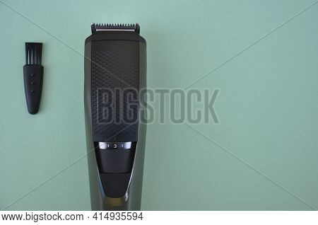 High Angle View Of Beard Trimmer With Brush With Negative Space, Modern Hair Trimmer Isolated On Gre