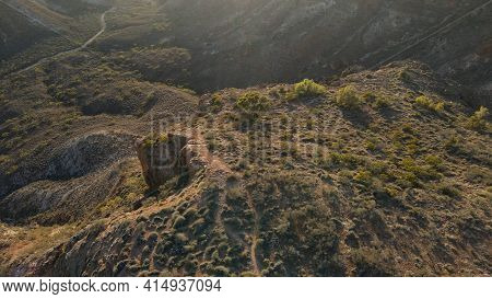 High Drone View Over A Spectacular Hilly Red Charles Knife Canyon On A Foggy Day During Sunrise In E