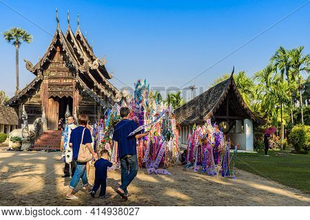 People Go To Ton Kwain Temple, Make Merit, Put A Paper Flag On The Sand Pagoda In Songkran Festival