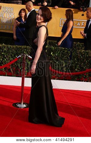 LOS ANGELES - JAN 27:  Michelle Dockery arrives at the 2013 Screen Actor's Guild Awards at the Shrine Auditorium on January 27, 2013 in Los Angeles, CA