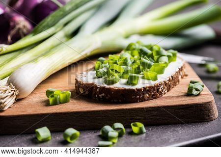 Bread With Spring Onion On A Chopping Board