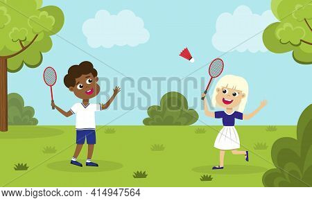 Children Playing Badminton. Girl And Boy With Badminton Rackets And Shuttlecock Playing On Green Law