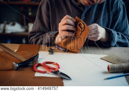 Desktop In The Shoemaker Workshop. The Process Of Making Leather Shoes. Hands Close-up Without A Fac