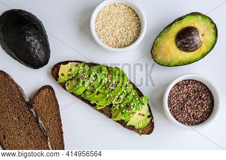 Ingredients For Healthy Avocado Toast. Ripe Hass Avocado, Wholegrain Bread, Sesame Flax Seeds. Vegan