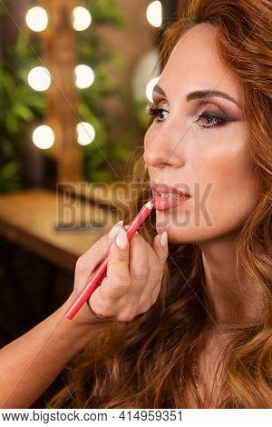 Makeup Preparation Process. Professional Makeup Artist Works On Model Face In Beauty Studio. Backsta