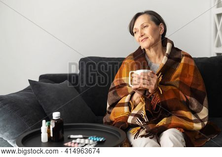 Smiling Senior Woman Feels Relieved, Recovering After Viral Disease. An Elderly Female Covered Blank