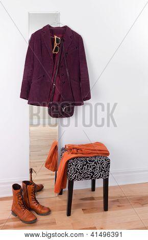 Purple Jacket Hanging On A Mirror