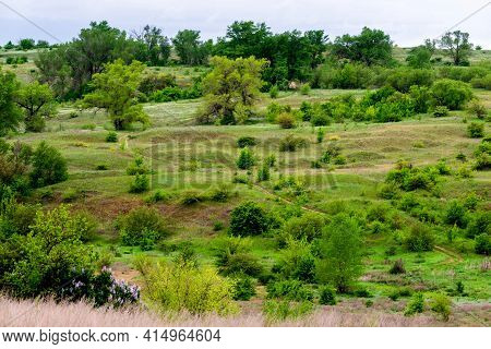 Beautiful Green Slopes Of Hills Landscape. Nature In Summertime