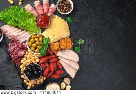 A Table Of Appetizers With Cold Cuts And Cheeses. Sausage, Ham, Olives, Cheese And Crackers For The