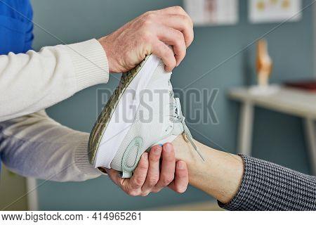 Orthopedist Checks Senior Patient Foot In A Rehab Center. Foot Injury, Sprained Leg, Achilles Tendon