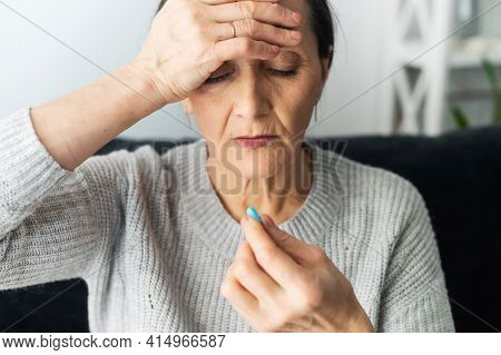 Senior Middle-aged Lady Grandmother Suffering From Strong Chronic Headache Or Migraine, Feeling Stre