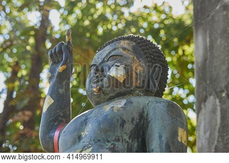 Phayao, Thailand - Dec 13, 2020: Headshot The Birth Of Buddha Statue On Forest Background In Wat Ana