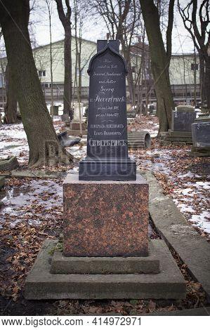Black Gravestone In Winter Cemetery Among Bare Trees - Smolenskoe Lutheran Cemetery, Russia, Saint P