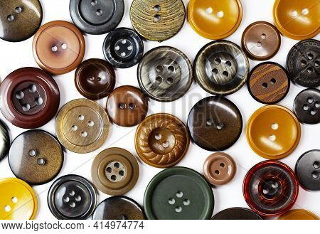Colorful Bright Brown, Beige And Ochre Buttons Background. Old Vintage Buttons Close-up. Copy Space.