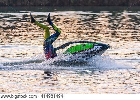 Krasnodar, Russia - October 25, 2020: Jet Ski Sportsman Runs Freestyle During South Russian Aquabike