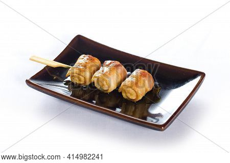 Japanese Skewered Of Sausage On White Background.