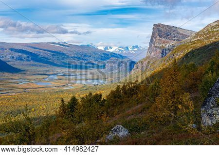 Wild, Beautiful Arctic Landscape Of Northern Sweden. Skierfe Mountain And Rapa River Valley In Early