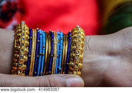 Stock Photo Of A Hand Of Indian Women Wearing Colorful Bangles With Gold Indian Design Bracelet, Pic
