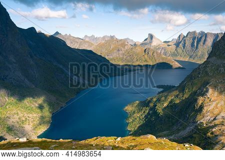 Steep Mountains Of Lofoten Island On A Sunny Arctic Day. View From Trail To Hermannsdalstinden Peak.