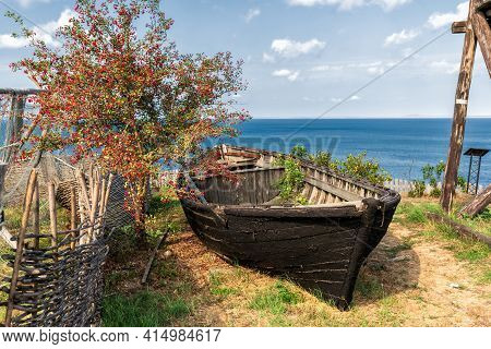 Serene Rustic Scenic Blue Sky Summer Landscape Of Wooden Peasant Boat, Red Berry Tree And Black Sea