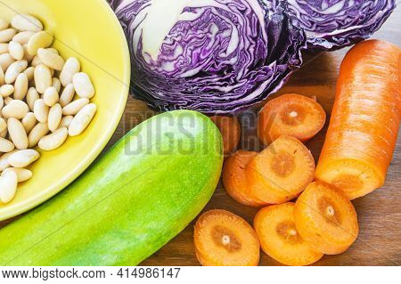 Ingredients For A Vegetarian Meal. White Boiled Beans In A Bowl, Cabbage, Cabbage And Carrots Are On