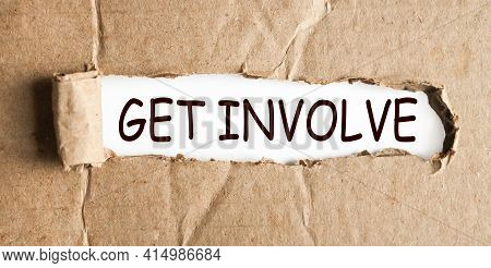Get Involved. Text On White Paper Over Torn Paper Background.
