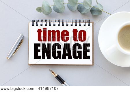 Time To Engage. Text On White Paper On Gray Background