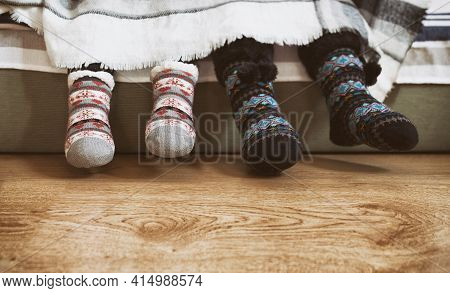 Two Children Wearing Winter Knit Anti-slip Socks. They Are Covered With White Blancket