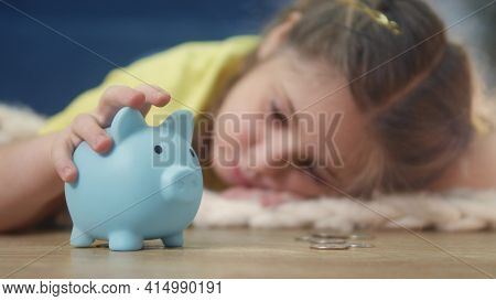 Girl Kid Child Puts Coins Save In A Piggy Bank Pig. Economy Finance Crisis Coronavirus Fund Concept.