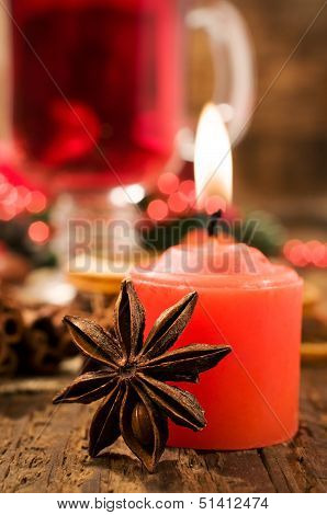 Red Candle And Christmas Spices Close-up
