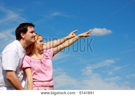 Two Young People Pointing Fingers