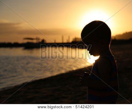 Little Boy Silhouette At The Beach