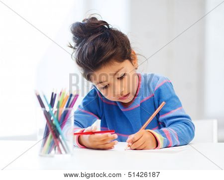 family, children and happy people concept - little girl drawing