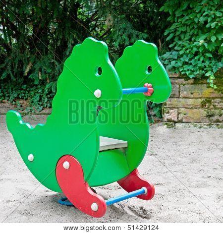 Child's Swing At The Playground