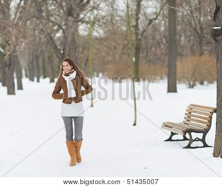 Happy Young Woman Walking In Winter Park