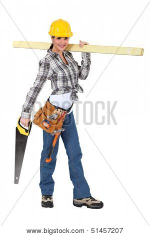 Female carpenter carrying  wood