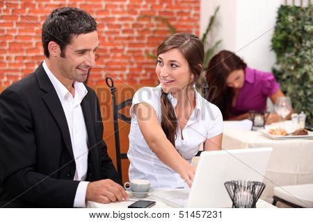 A business meeting in a restaurant