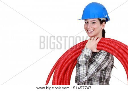 female plumber carrying hose