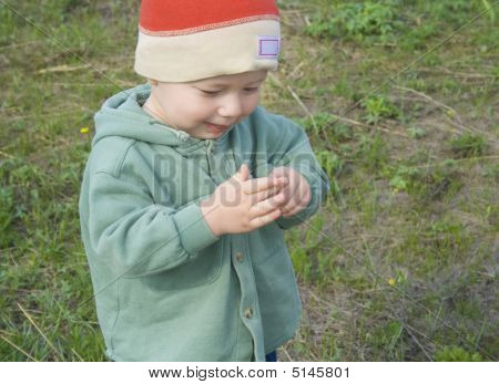 Smal Boy Is Playing With His Finger